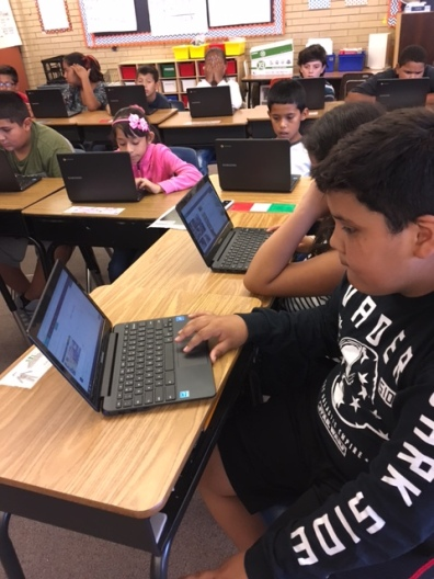 Using Chrome books to complete their PBL project